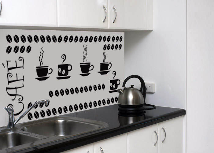Kitchen worktop with kettle and stainless steel double sink and white cupboards.