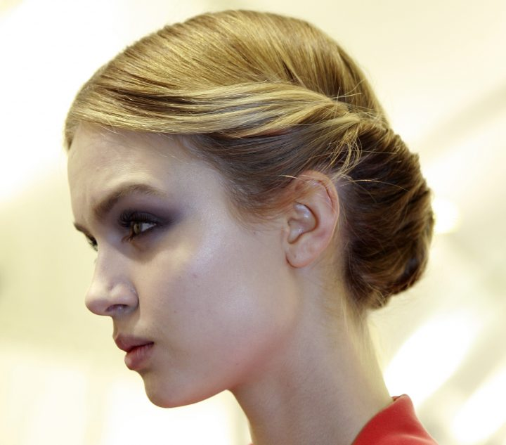 A model backstage at Valentino's fall 2012 runway show at Espace Ephemere Tuileries.