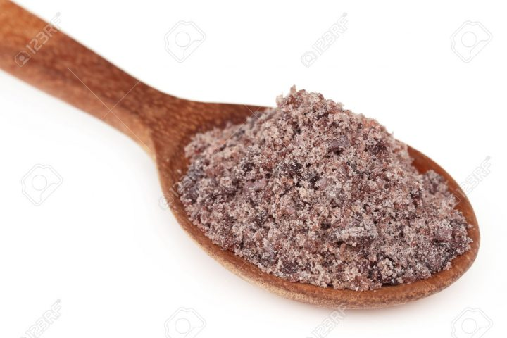Kala namak or Black salt of South Asia on a wooden spoon